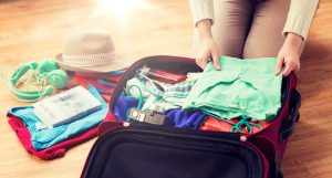 Close up of woman packing for travel